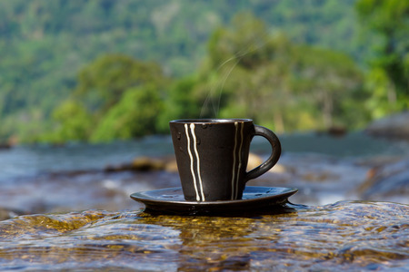 Refreshments and coffee on the rocks at the waterfalls. photo
