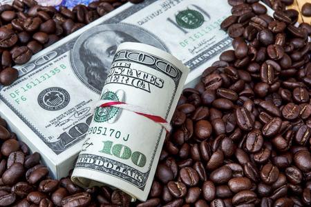 Money and roast coffee bean. photo