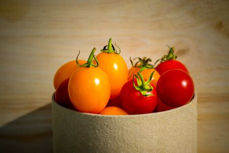 Small Red and Yellow tomato. photo
