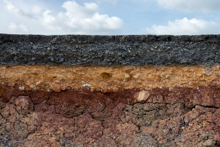 The curb erosion from storms. To indicate the layers of soil and rock. photo