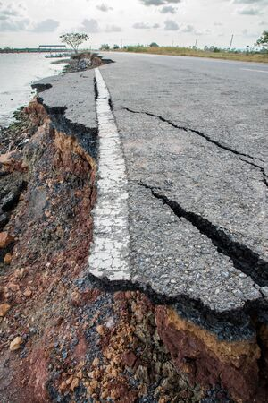 Side of the broken asphalt road collapsed and fallen photo