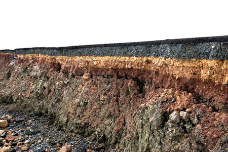 soil: The curb erosion from storms. To indicate the layers of soil and rock.