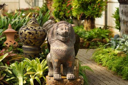 ancient lion: Simulation ancient lion statue in the park.