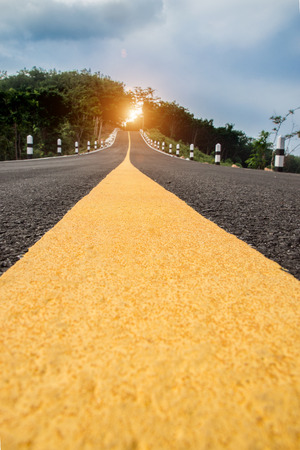 One yellow traffic line on the empty road.