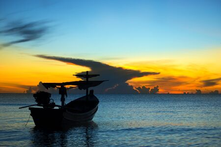 afloat: Silhouettes of Fishing boat on the sea.