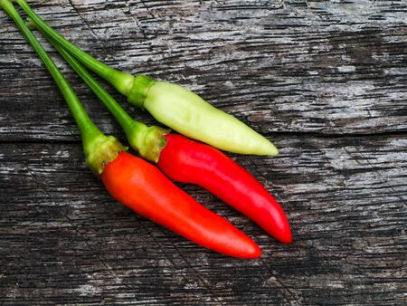 tabasco: hot chili peppers on the old wood in nature.