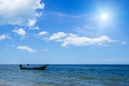 afloat: Fishing boat on the sea  with blue sky and sunlight. Stock Photo