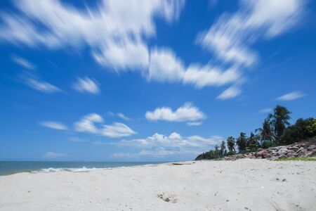 afloat: Motion cloud on blue sky over the beach.