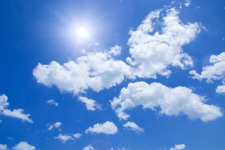 white clouds: Blue sky with white clouds and sun.