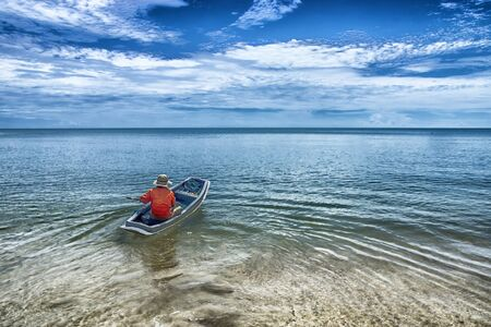 fishing boat: Fishing boat into the sea.