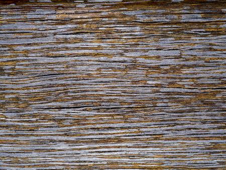 exfoliate: Peeling paint on old wood.