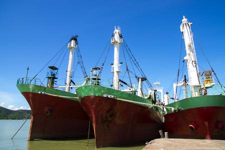 old ship: Three Old Cargo ship in harbor estuary. Thailand.