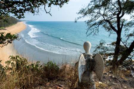 stone tombstone: Guardian angel statue on the cliffs of the island, Thailand. Un-focus image. Stock Photo