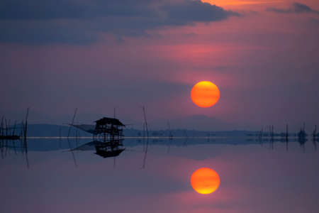 mirror image: Mirror image of Sunset at the lake, Thailand.