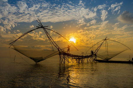 fishing gear: Lifestyle of fishing gear with sunrise at lake, Thailand.