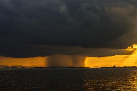 rainfall: Cloudscape scene a rainfall at sunset time.