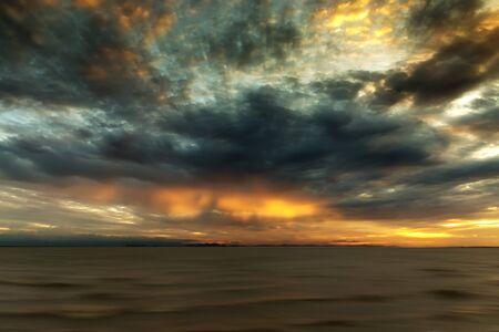 rainfall: Cloudscape scene and rainfall with sunlight.