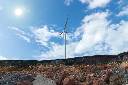 empedrado: Layers of road with soil and rock under the wind turbine. Foto de archivo
