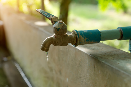 Defective faucet. Cause wastage of water Stock Photo