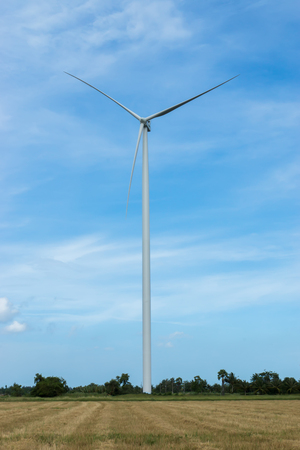 generate: Wind turbines generate electricity in the Paddy fields. Thailand. Stock Photo