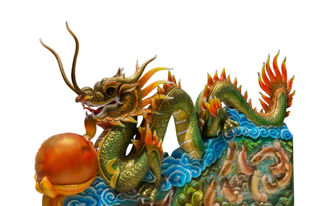 Traditional dragons at the Chinese temple isolate on white background.