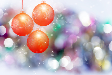 Rad Christmas balls with Abstract light color bokeh background. Stock Photo