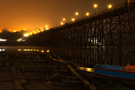 Sangkhlaburi wooded bridge over the river before sunrise Karnjanaburi. Thailand. Stock Photo