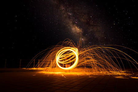 steel wool: Long exposure of steel wool photography at night with milky way and grain on the sky.