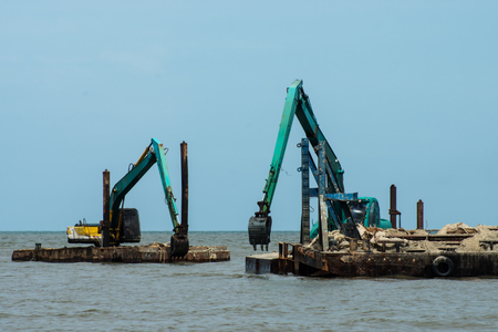 Machines are dredging sand in the sea. For use in industry.