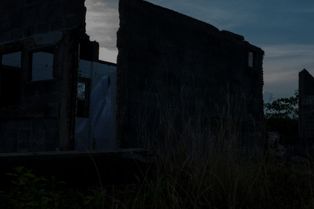 Low key image a blur white ghost at Abandoned house. Concept: Halloween Festival