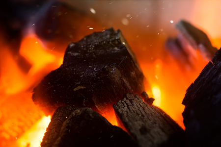 Close up of Charcoal burning with floating dust. (Un-focus image)