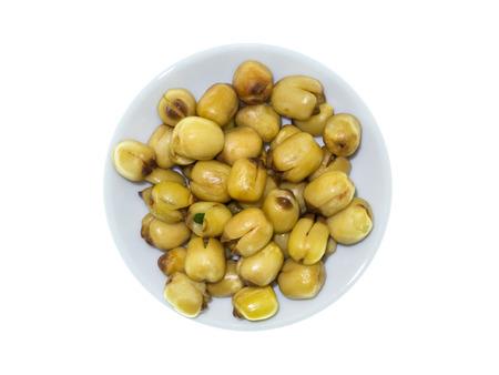 Lotus seeds roasted on white background. Stock Photo