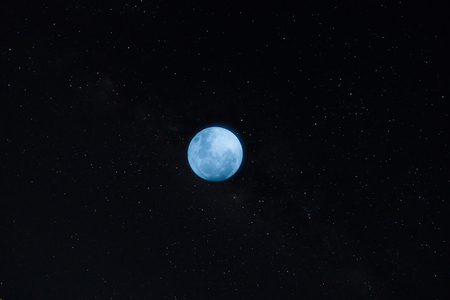 The Blue moon in the dark night with star.