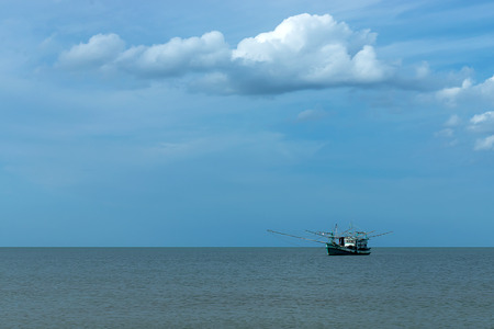 Minimal of Fishing boat on the sea with sky and cloud.