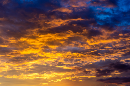 Golden hour of sunset sky and beautiful clouds. Stock Photo