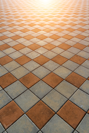 Close up line and squares on walkway background with sunlight.