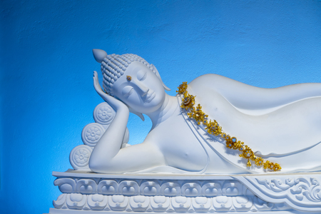 Close up white buddha sculpture with blue wall background in Wat Phra Sorn Kaew, Ban Khao Kho, Phetchabun. The landmark travel of thailand.