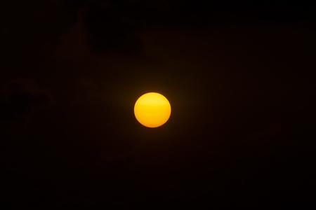 Big sun on Sunset sky with dark background 版權商用圖片