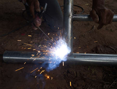The male laborer, a maintenance worker, was using a metal brazing gas welding machine without dangerous tools at the factory.