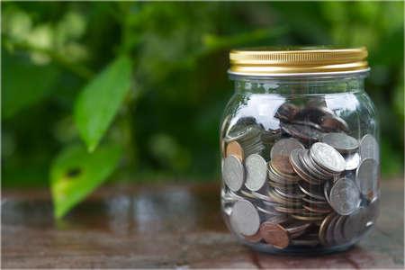 Coin jar of savings planning saving money.