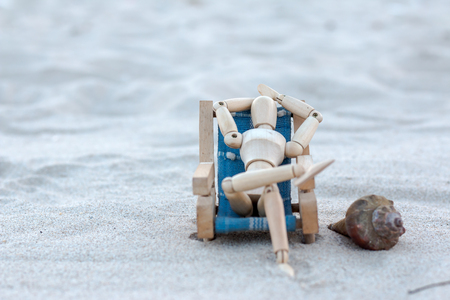 Wooden puppet at the beach