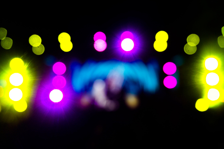 Defocused entertainment concert lighting on stage,  Festival event party night lights blurred abstract colorful bokeh background. party bokeh concept.