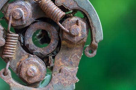 A piece of old engine car spare part. Rusty iron surface. The rust on steel Texture. Decay metal object.