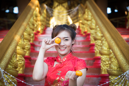 Chinese woman wearing traditional costume during Chinese New Year.