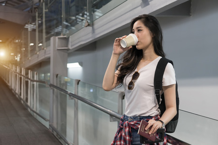 Beautiful young Asian woman arrives airport early morning ready going aboard foreign country.