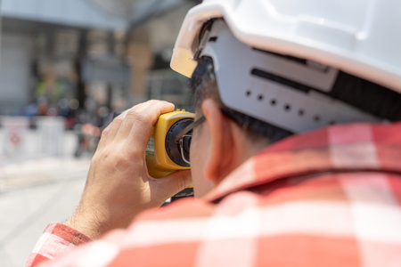 Civil engineer land survey with tacheometer or theodolite equipment. Worker Checking construction site on the road. Surveyor engineer making measuring with theodolite instrument level tool. Stock Photo - 120783630
