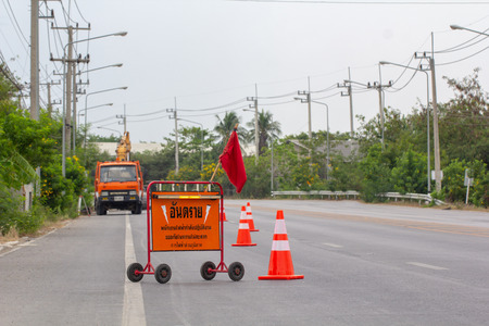 "Bangkok, ThailandApril 1, 2019: Road closed diagonal stripe barrier ""Danger"" detour sign by Thailand metropolitan electricity working repair electrical system. Editorial"