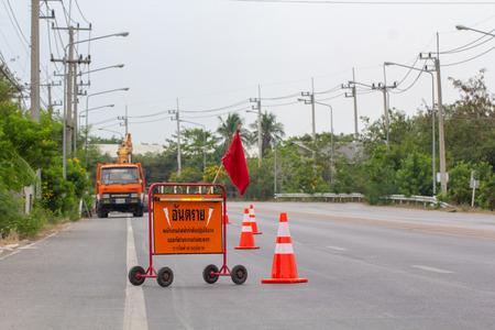 "Bangkok, ThailandApril 1, 2019: Road closed diagonal stripe barrier ""Danger"" detour sign by Thailand metropolitan electricity working repair electrical system."