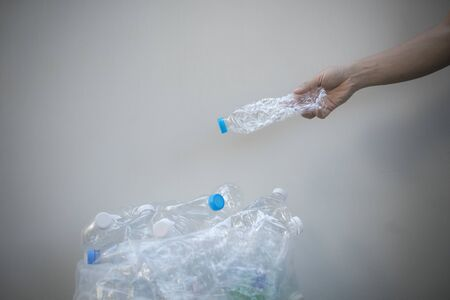 Hand holding plastic bottle garbage for recycling, reuse concept.hand holding plastic bottle to dispose in trash, waste management and plastic recycle concept.