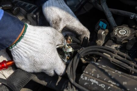 Check engine ignition system and change ignition coil. Car care service.